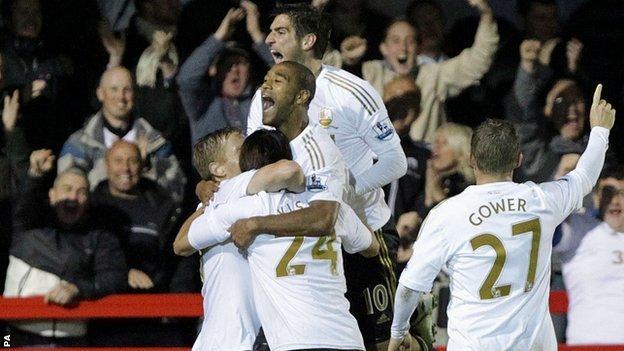 Swansea players mob match-winner Garry Monk