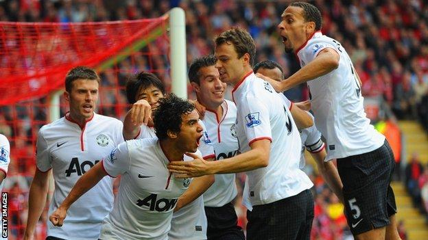 Rafael is congratulated by team-mates after scoring against Liverpool