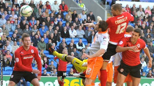 Matthew Connolly scores Cardiff's third goal against Blackpool
