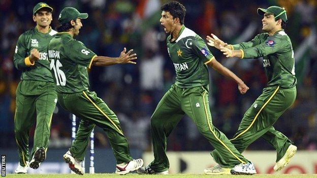 Pakistan celebrate taking a wicket against India