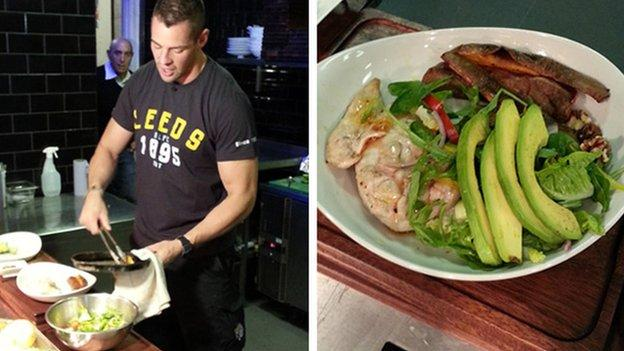 Ian Kirke prepares food for team-mate Ryan Hall