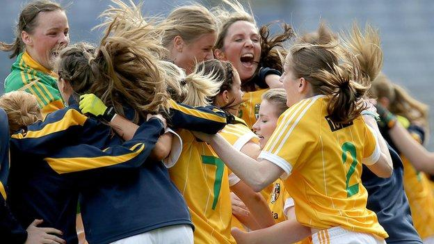 Antrim players celebrate after winning the Junior final