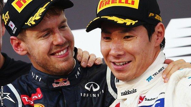 Sebastian Vettel and Kamui Kobayashi