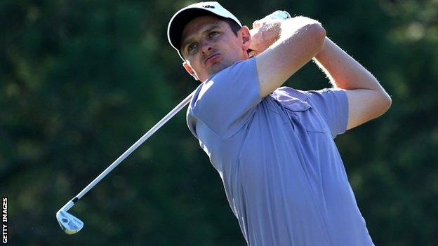 Justin Rose in action hits an approach in the final against Lee Westwood
