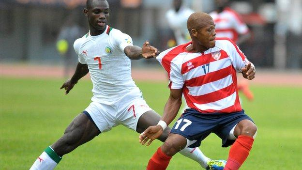 Gebro Georges (right) in action for Liberia.
