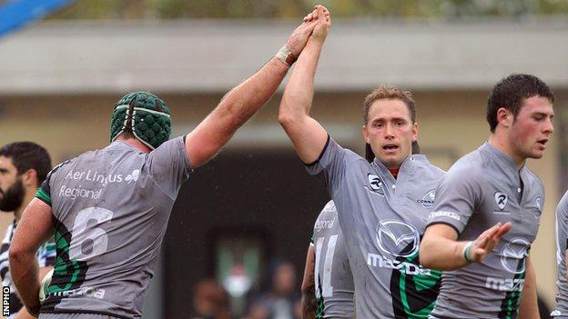 Dan Parks congratulates John Muldoon after the flanker's try in Parma