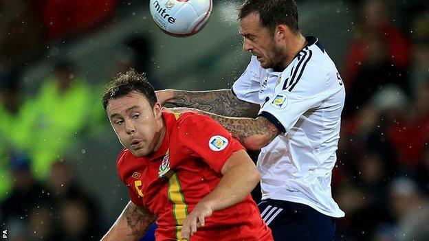 Darcy Blake in action against Scotland's Steven Fletcher
