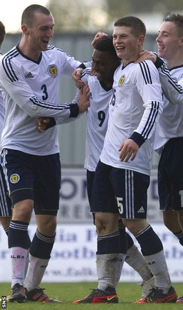 Fellow scorer Jo Chalmers (left) congratulates Feruz against Switzerland