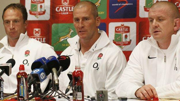 Stuart Lancaster (centre) is flanked by assistant coaches Mike Catt (left) and Garaham Rowntree (right) after England's third Test against South Africa