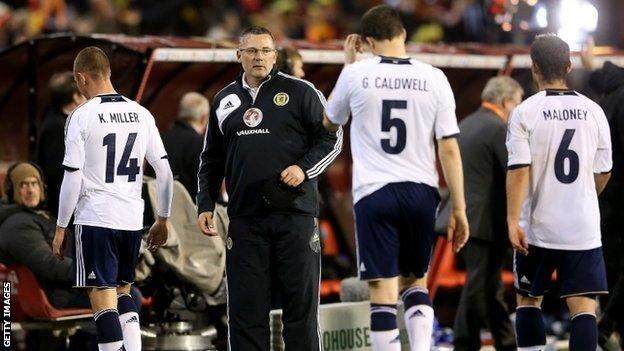 Craig Levein and his players troop off after the defeat in Brussels