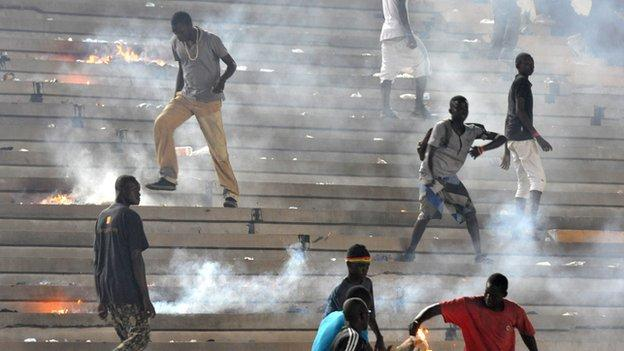 Senegalese fans riot in the stands at the Stade Leopold Senghor on Saturday