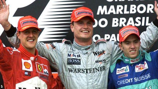 David Coulthard (centre) celebrates one of his 13 grands prix victories