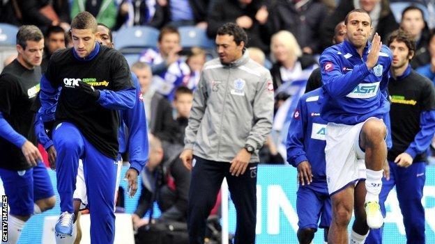 QPR's Anton Ferdinand (right) did not wear a Kick It Out T-shirt