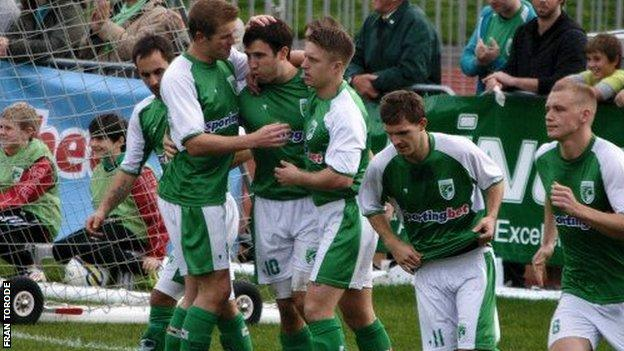 Hat-trick man Ross Allen is congratulated by his team mates