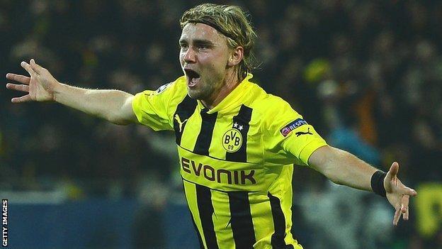Marcel Schmelzer of Dortmund celebrates after scoring against Real Madrid