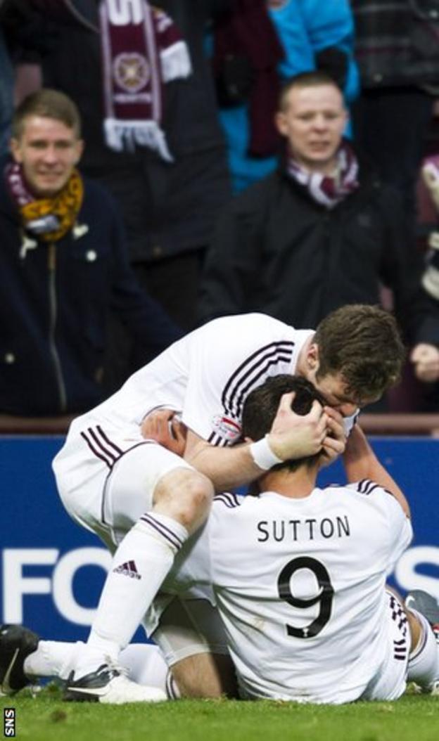 Darren Barr congratulates Hearts goalscorer Darren Barr