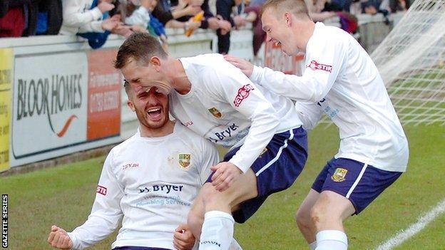 Tom Knighton celebrates scoring for Yate Town with Scott Thomas and Matt Groves