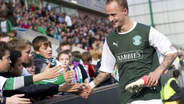 Hibs striker Leigh Griffiths greets the fans at Easter Road
