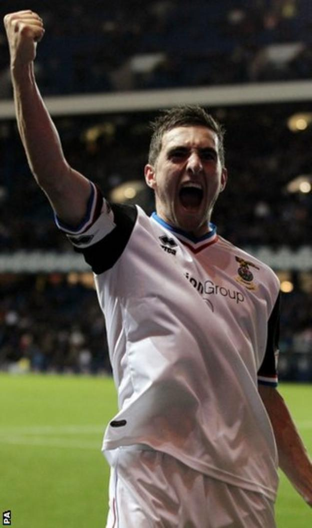 Invernesss Graeme Shinnie celebrates scoring the third goal in the win at Ibrox