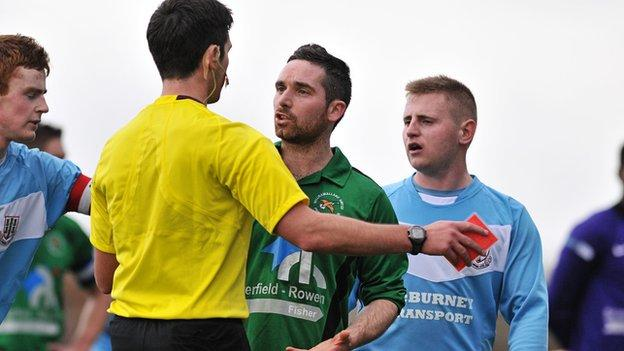 Jason McCartney is shown the red card against Ballymena