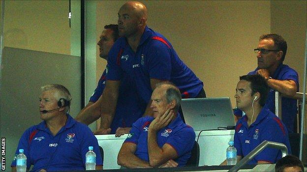 Adam Trypas along with Wayne Bennett's coaching team at Newcastle Knights