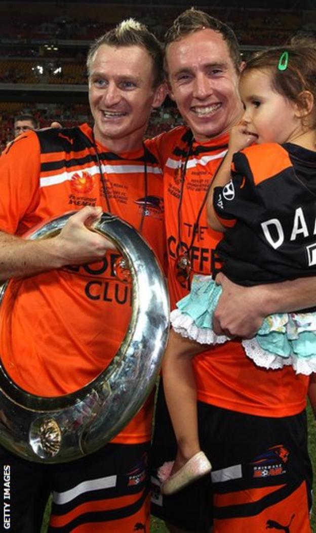 Besart Berisha and Matthew Smith celebrate Brisbane Roar's A-League Grand Final win over Perth Glory