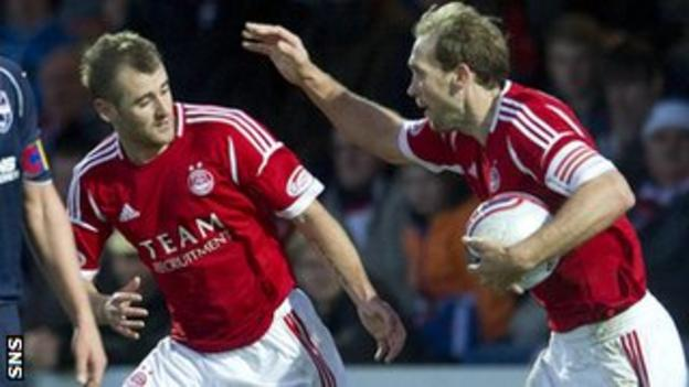 Niall McGinn and Russell Anderson