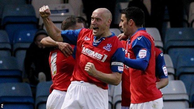 Gillingham celebrate a goal