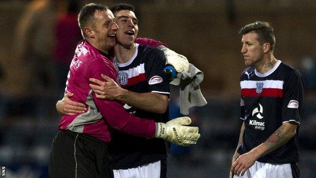 Goalkeeper Rab Douglas congratulates defender Declan Gallagher