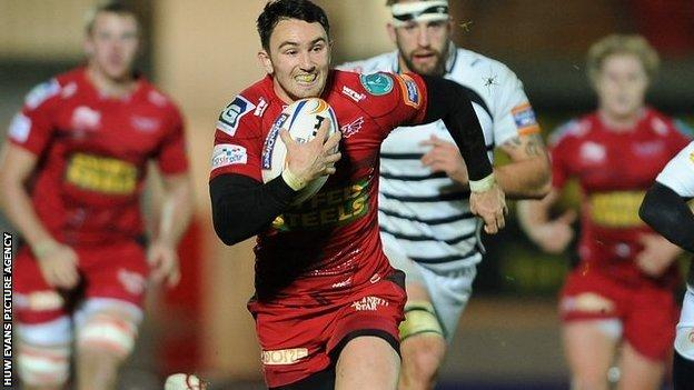 Kristian Phillips races away for the Scarlets