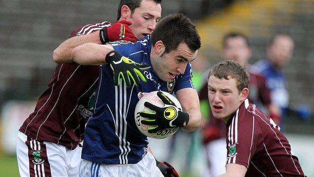 St Gall's forward Kevin Niblock is challenged by Damien Kelly and Aidan Breen
