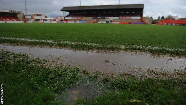 Whaddon Road's flooded pitch on Sunday
