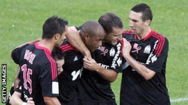 Andrew Ayew (second from left) is congratulated by his team-mates