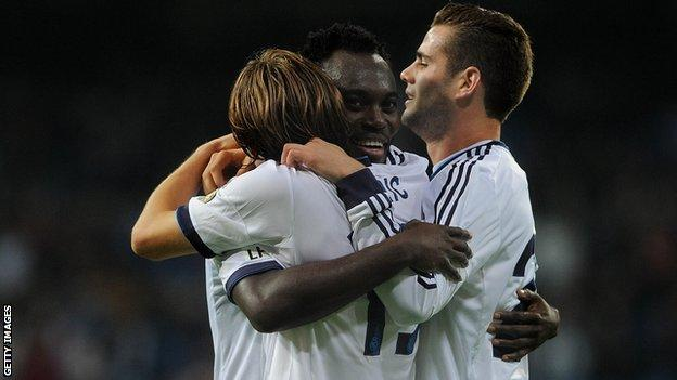 Michael Essien (centre) celebrates after scoring his first goal for Real Madrid