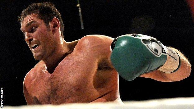 Tyson Fury throws a punch