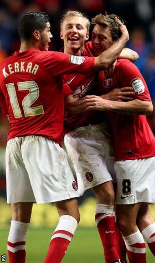 Charlton's Dale Stephens (right) is mobbed after scoring his side's third goal