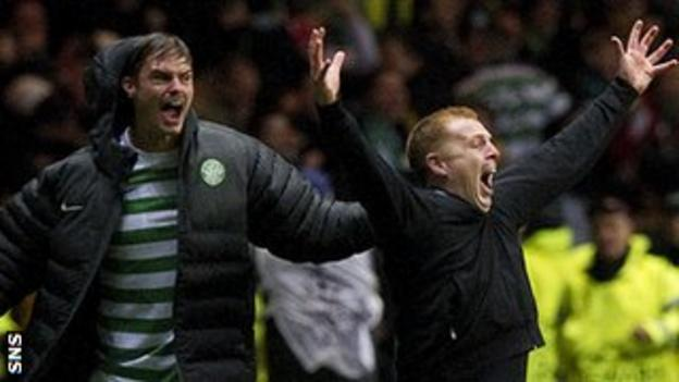 Celtic manager Neil Lennon (right) celebrates a famous win