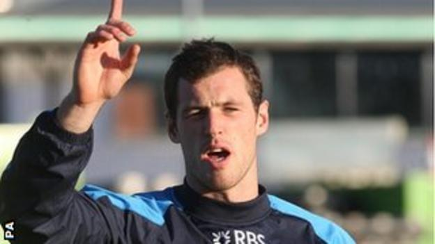 Scotland wing Tim Visser raises his arm in training as he prepares to face New Zealand