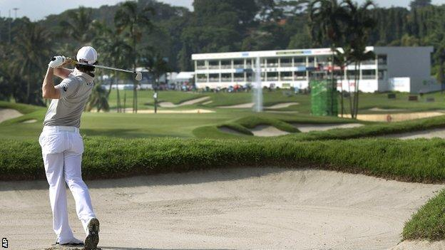 Rory McIlroy plays to the 16th green at the Sentosa Golf Club
