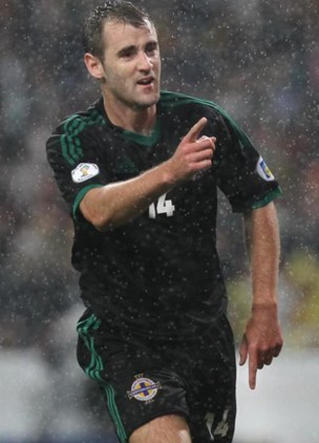 Niall McGinn celebrates after scoring against Portugal