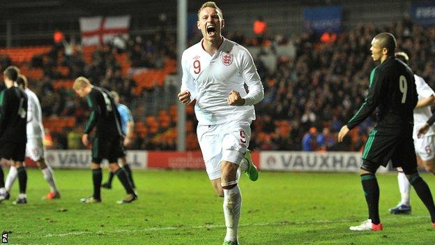 Connor Wickham celebrates scoring for England-U21s against Northern Ireland.