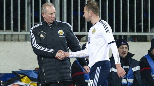 Billy Stark congratulates Scotland striker Jordan Rhodes on his two-goal performance