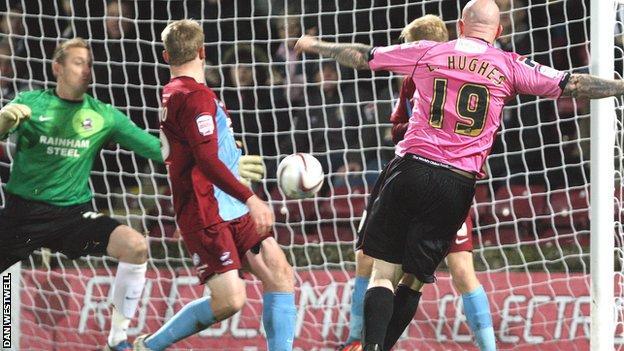 Lee Hughes scores