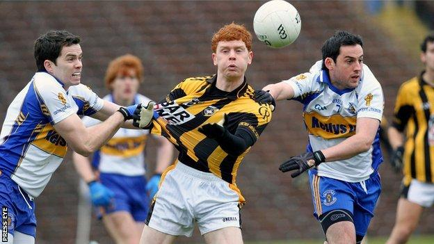 Errigal's Michael McRory and Davy Harte challenge Kyle Carragher