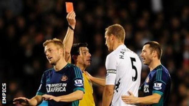 Referee Lee Probert showed Fulham defender Brede Hangeland a straight red card for his challenge on Lee Cattermole