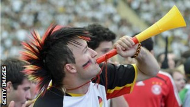 German supporter with a vuvuzela