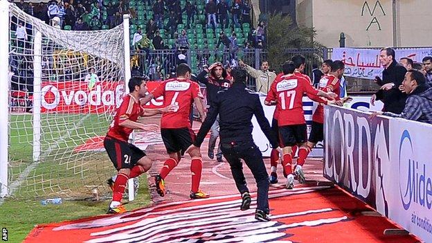 Ahly players flee during Port Said riot