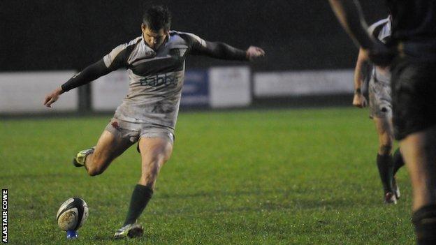Scott Davidson kicks the winning penalty for Guernsey