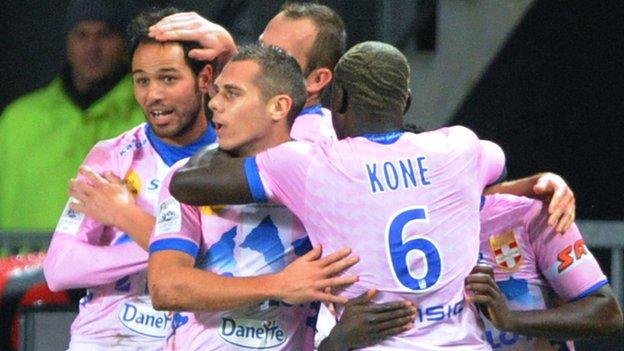 Zouhaier Dhaouadi (left) celebrates scoring for Evian