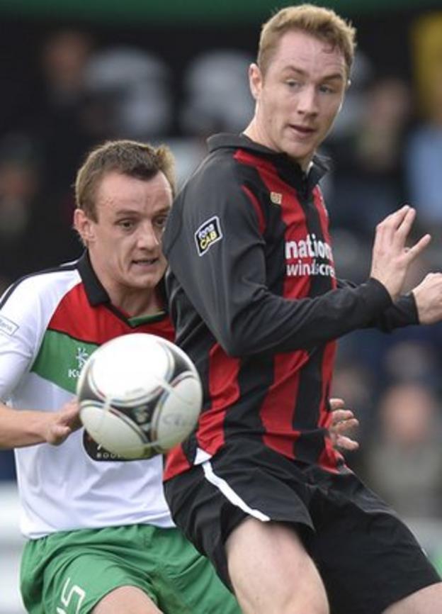 Glentoran's Jason Hill in action against Crusaders striker Timmy Adamson
